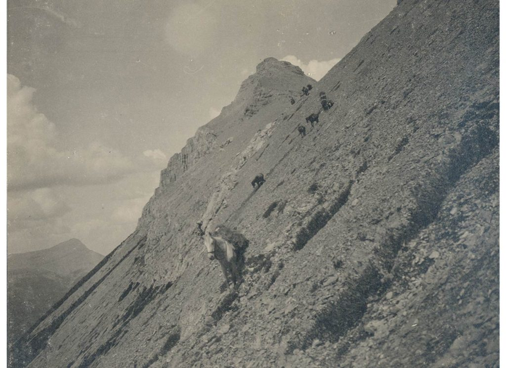 Fay expedition navigating a difficult scree above Whatley Creek